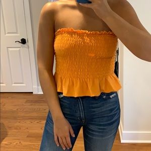 orange strapless top from Urban Outfitters